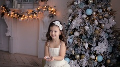 Little girl of three years throws silver glitter Stock Footage