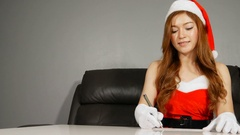 Smiling woman in santa helper hat and santa claus clothes Stock Footage