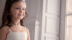 Little girl three years old in a white dress smiling Stock Footage