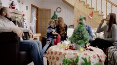 Happy familes sitting at the table at christmas party Stock Footage