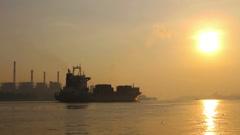 Large Cargo Shipping Boat at sunrising Stock Footage