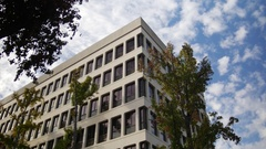 ESTABLISHING SHOT OF A MID-SIZE OFFICE BUILDING.  4K. Stock Footage