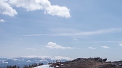 Timelapse mountains with snow-covered pine forests over which runs lit Stock Footage