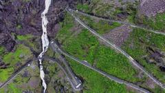 Troll's Path Trollstigen or Trollstigveien winding mountain road in Norway. Aeri Stock Footage