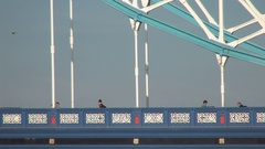 Double-Decker Bus Traffic and Tourist Crossing Tower Bridge Metallic Structure. Stock Footage
