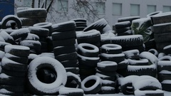 Stacks of tires covered with snow Stock Footage