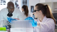 4K Scientific research team working in the lab with chemicals & test tubes Stock Footage