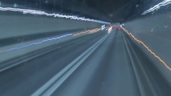Timelapse with a bus crossing a road tunnel under a mountain. Stock Footage
