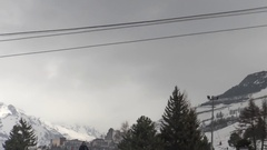 Timelapse with an installation cable that works over ski runs that go Stock Footage