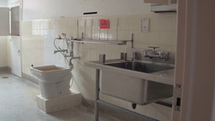Abandoned toilet and sink in old sanitarium Stock Footage