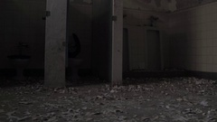 Abandoned urban blight - bathroom peeling paint - post apocalyptic Stock Footage