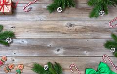 Complete Christmas border of seasonal objects on rustic wood Stock Photos
