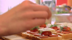 Woman preparing a tasty sandwiches. Small square sandwich. Stock Footage
