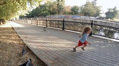 SLOW MOTION. Children scare the pigeons Stock Footage