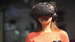 Girl playing video game with HTC Vive VR glasses Stock Footage