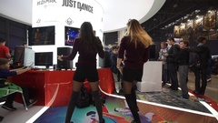 Two girls playing dance video game Just Dance 2017 Stock Footage