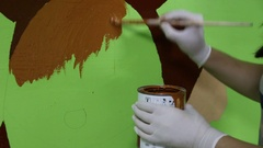 Hand painting green wall Stock Footage
