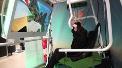 Girl uses virtual reality glasses flying on air balloon in video game Stock Footage