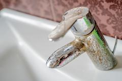 Hard water deposit on a tap Stock Photos