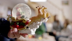 Snow globe, happy familes talking christmas party Stock Footage
