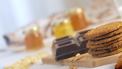 A woman hand add a cookie to a tasty stack. Camera slider  closeup shot Stock Footage
