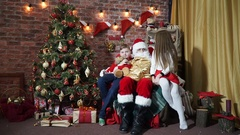 Girl takes the bag of Santa Claus with gifts and teddy bear Stock Footage