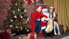 Children receive gifts from Santa Stock Footage