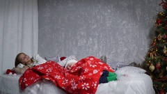 Santa sneaking up to sleeping babies on Christmas Eve Stock Footage