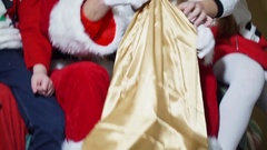 Close-up of a boy and a girl took out the presents from Santa's bag Stock Footage