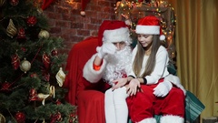 Santa Claus shows magic for girls Stock Footage