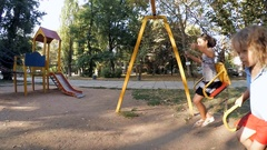 Children ride on a swing at the site Stock Footage