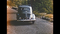 Vintage 16mm film, 1955 France, concept - woman rides on hood of car, funny Stock Footage