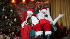 Little girl lying kneeling at Santa Claus Stock Footage