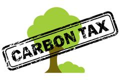 Carbon tax rubber stamp over tree icon Stock Illustration