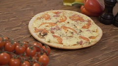 Rotating Pizza tomatoes pepper Stock Footage