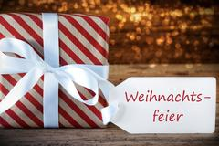 Atmospheric Gift With Label, Weihnachtsfeier Means Christmas Party Stock Photos