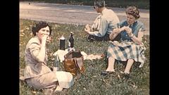 Vintage 16mm film, 1955 France, people roadside picnic wine, life is good Stock Footage
