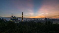 Timelapse. Sunrise sky over Kuala Lumpur mosque Stock Footage
