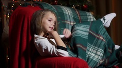 Girl sitting in a chair waving his foot and flirting Stock Footage
