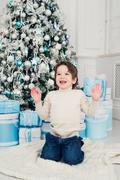 Holidays, presents, christmas, x-mas concept - happy child boy with gift box Stock Photos