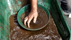 Water is sifted in search of gold nuggets. Detail in slow motion Stock Footage