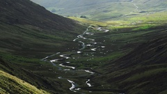 Cars traveling a winding road of Hardknott pass in the English lake district. Stock Footage