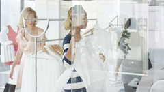 4K Beautiful female customers shopping in fashionable boutique clothing store Stock Footage