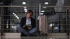 Problem with transportation, delay of flight, depressed man with his luggage and Stock Footage