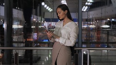 Young female entrepreneur reading electronic book on digital tablet in modern Stock Footage