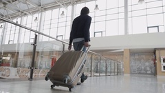 Business man with suitcase in hall of airport, student freelancer travelling Stock Footage