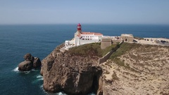 Aerial. Filmed from the sky lighthouse on top of cliff at Cabo Sao Vicente Stock Footage