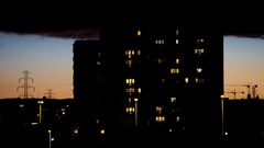 Time lapse residential block at night with moving clouds background Stock Footage
