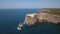 Aerial. Filmed with a bird's eye view, lighthouse Cabo Sao Vicente Stock Footage