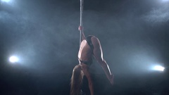 View of sexy dancer doing handstand near pylon Stock Footage